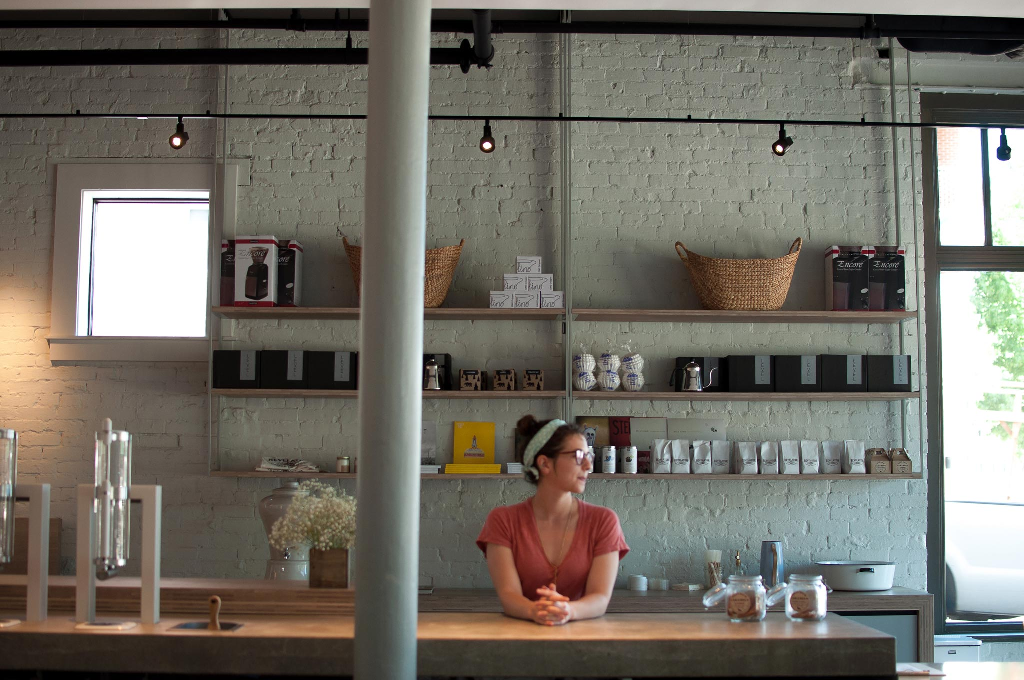 Revelator Chattanooga modern coffee shop inside view of employee working at the coffee shop