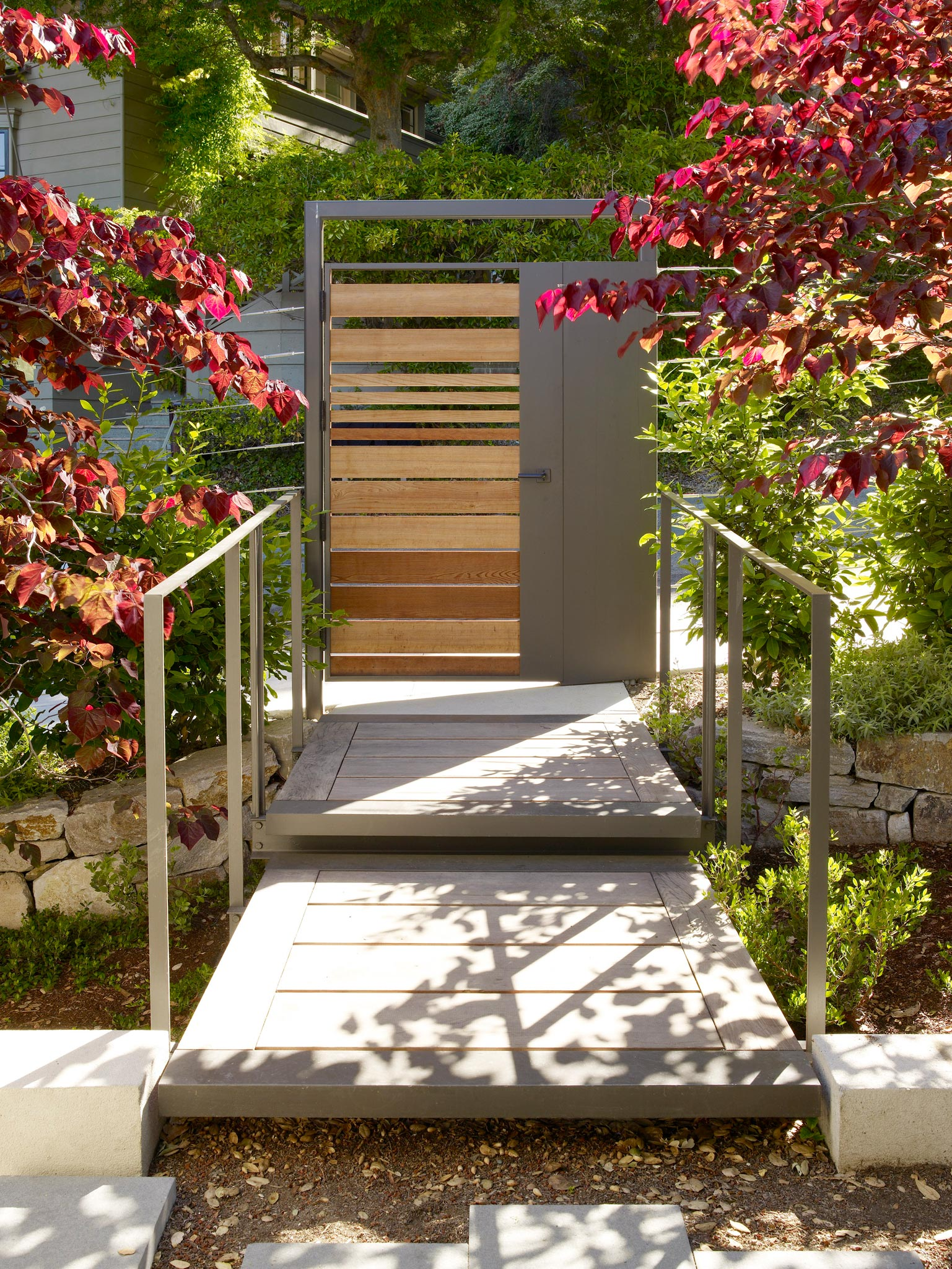 Claremont modern aesthetic pavillon house guest outside view of gate
