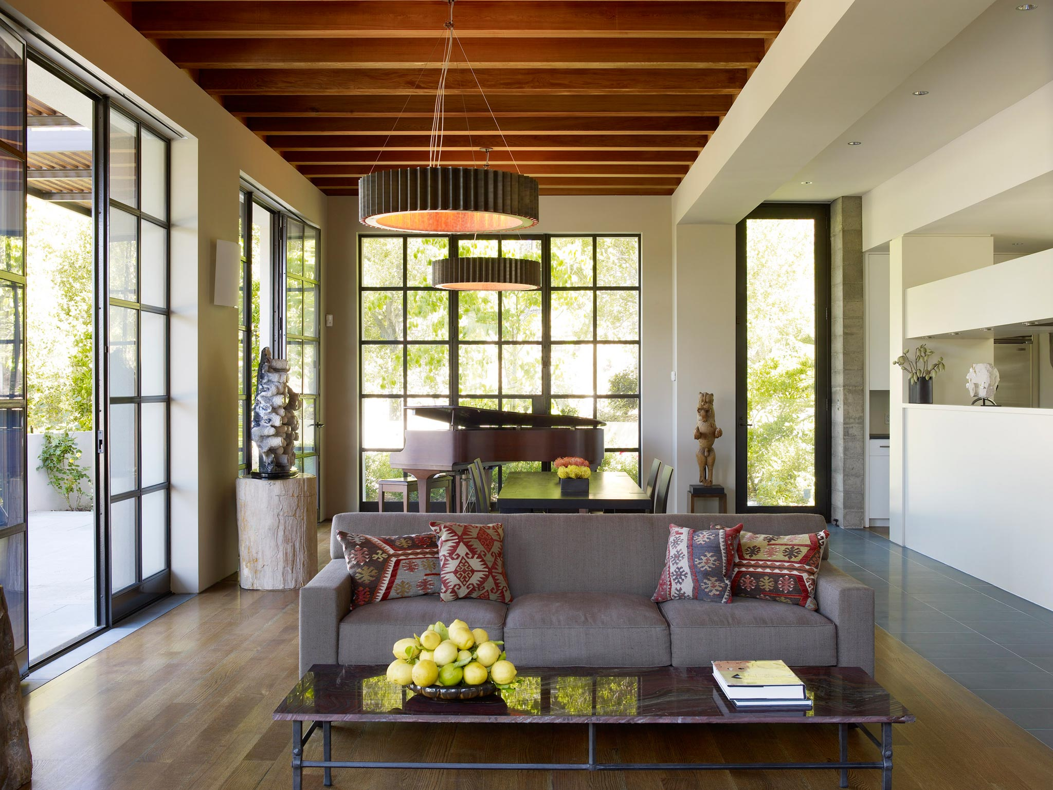 Claremont modern aesthetic pavillon house guest inside view of living area facing a couch