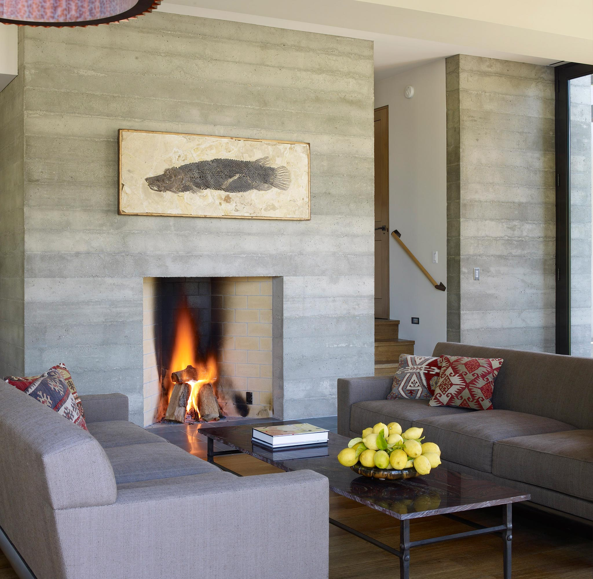 Claremont modern aesthetic pavillon house guest of living space with fireplace