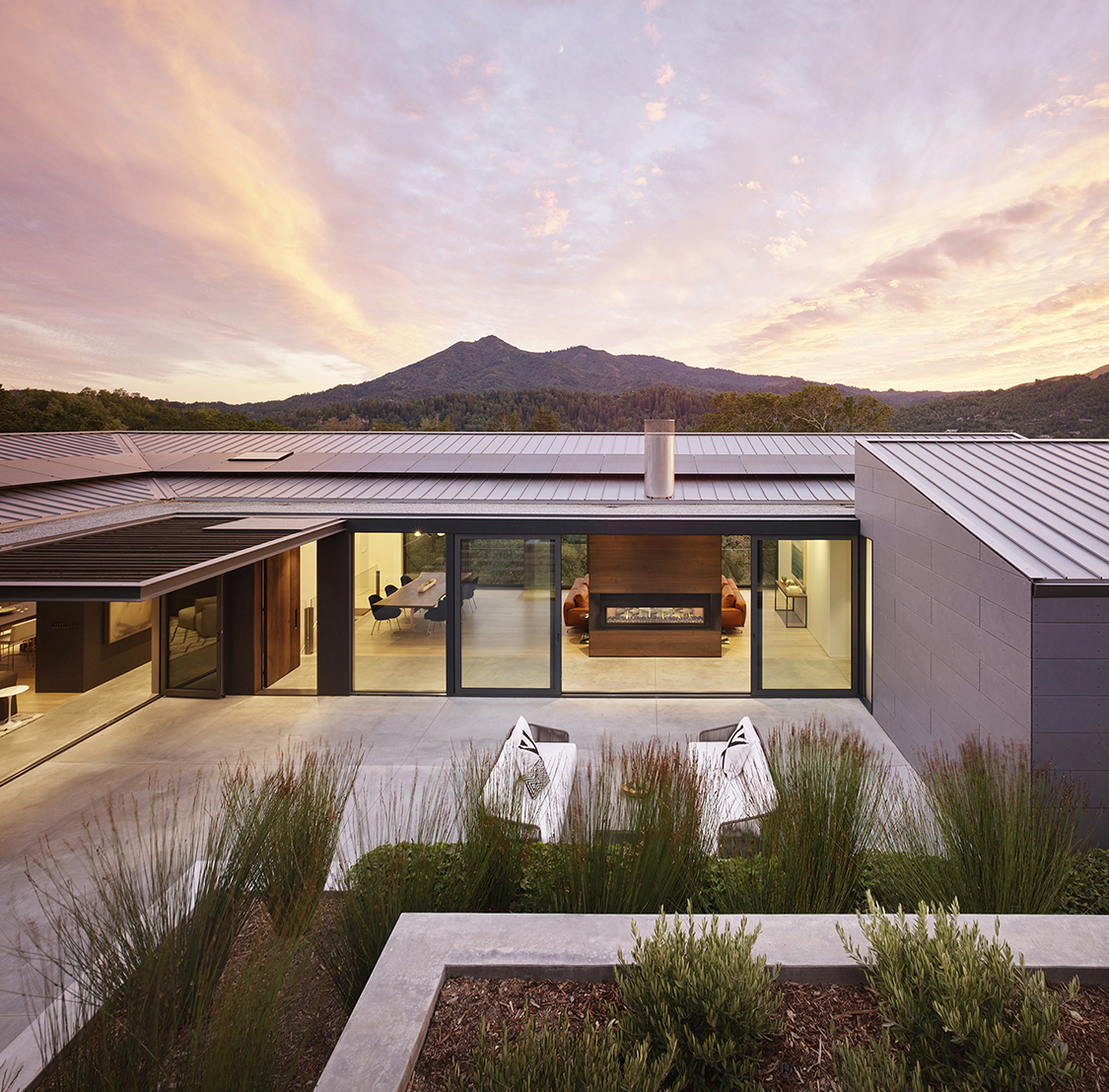 Ross Hillside modern home outside view with sunset