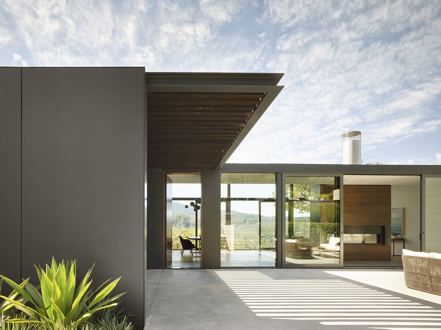 Ross Hillside modern home outside view with terrace area