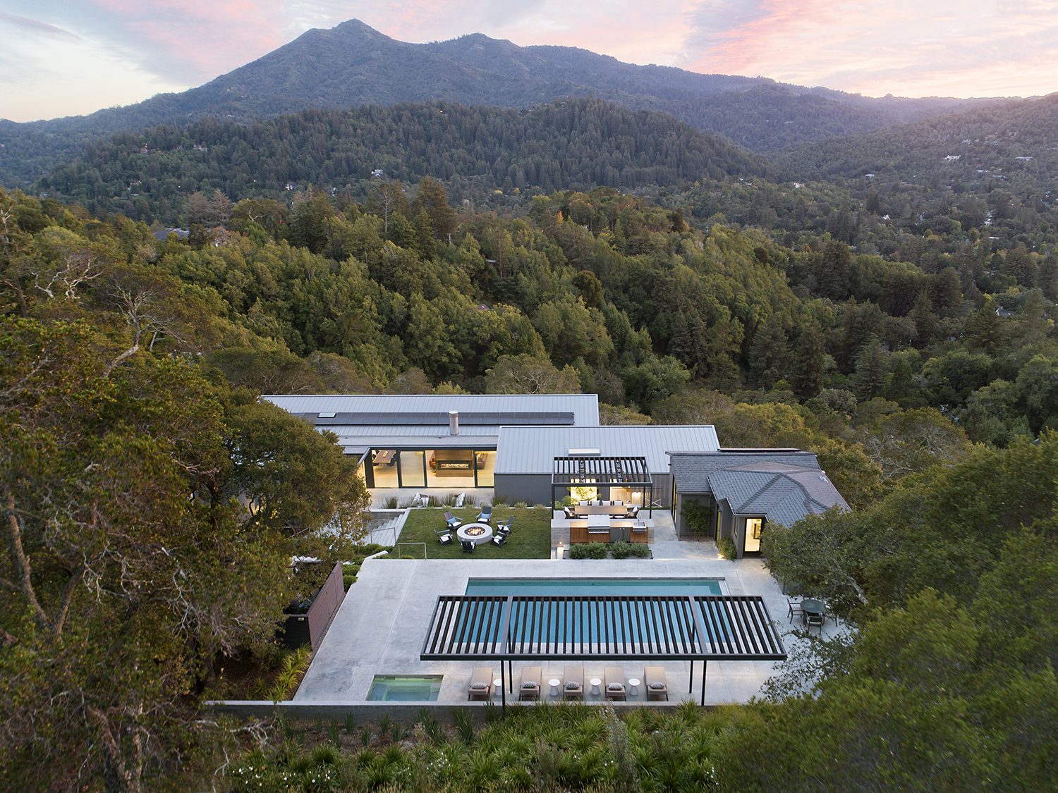 Ross Hillside modern home aerial view of house and swimming pool