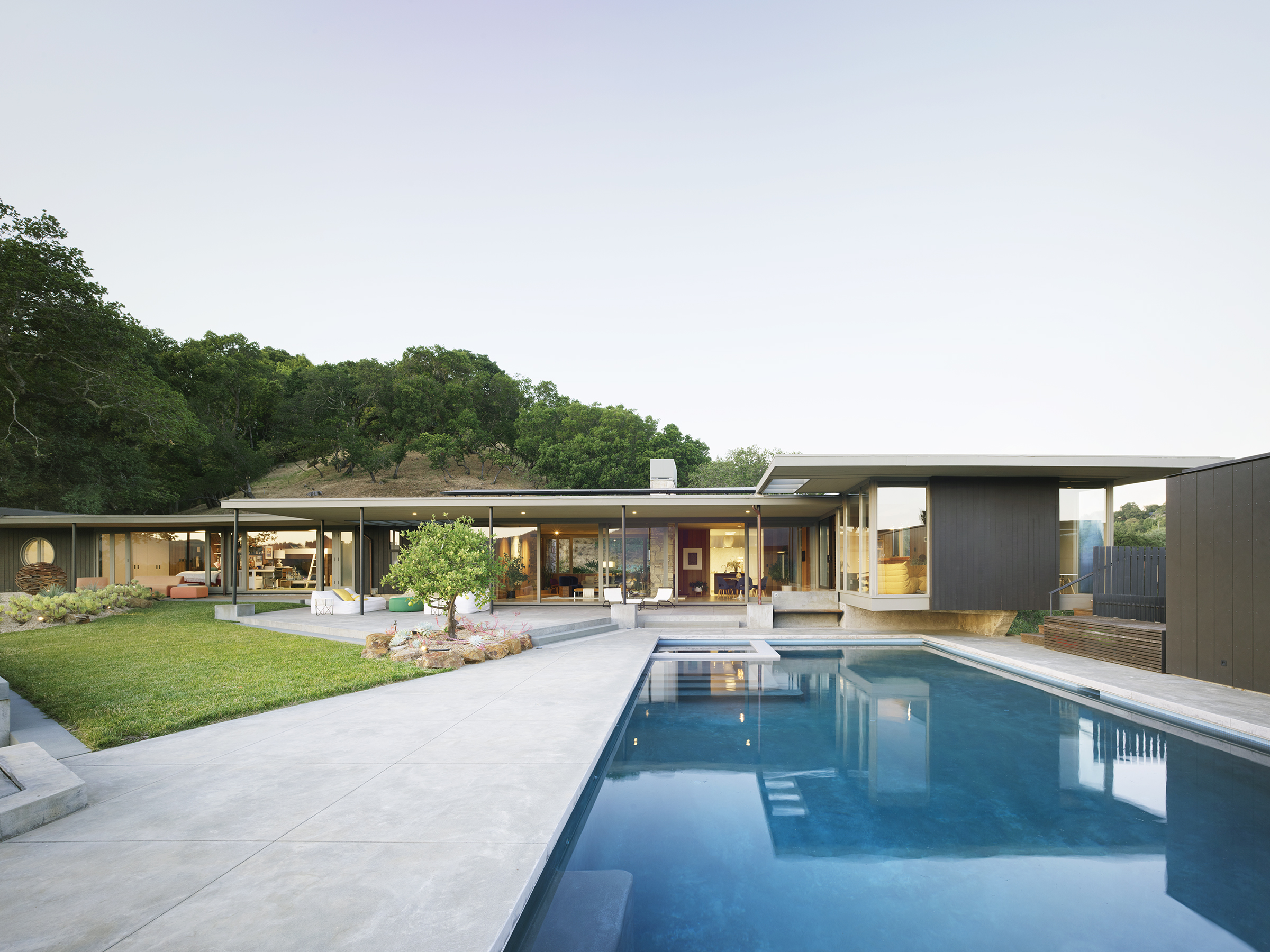 Herspring House renovated in Kentfield California, outside view of the house with swimming pool and garden