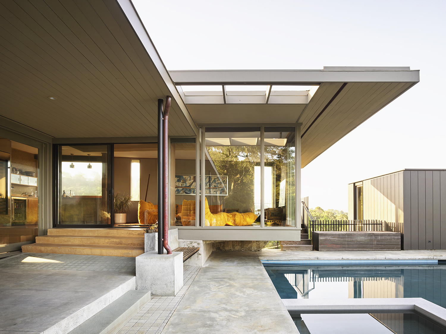 Herspring House renovated in Kentfield California, outside view of pool and living space