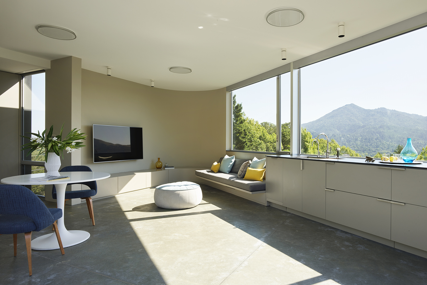 Herspring House renovated in Kentfield California, inside view of living space with big window facing a mountain